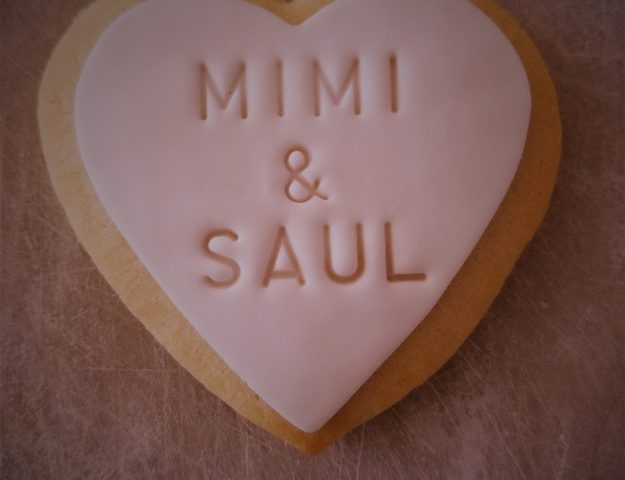 personalized stamp on a fondant covered sugar cookie