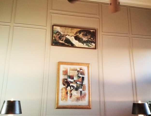 idea for decorating large walls using panel moulding