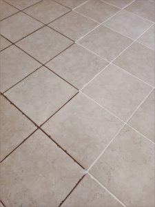 Make grout cleaner looking with grout paint
